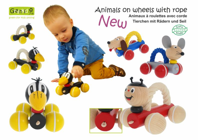 Greenkid pull-along and push-along wooden toys. Wooden animals with a rope on wheels: Ladybird - Dog - Raven - Mouse - for children's joy by Abafactory the Czech manufacturer of wooden toys.